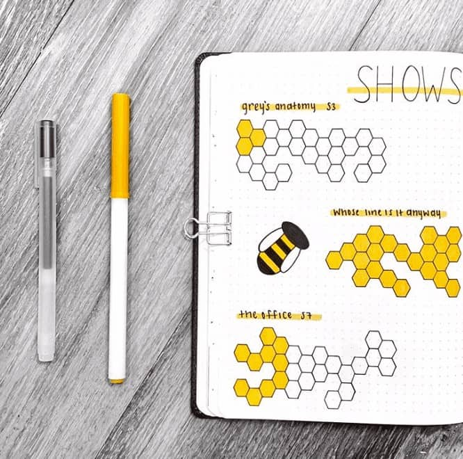 Yellow TV Show watch list with yellow filled in honey combs to track it