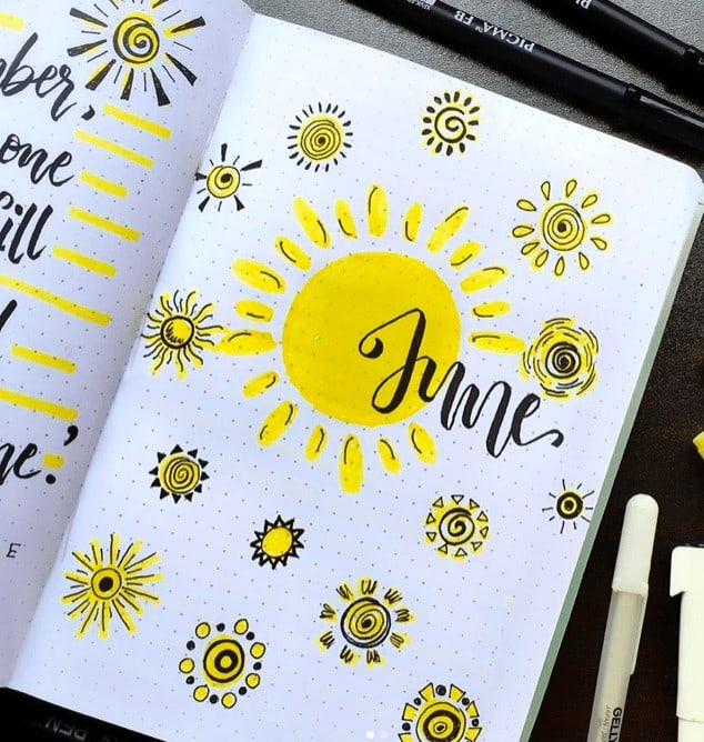 June Cover Page with many doodled yellow suns in a bullet journal