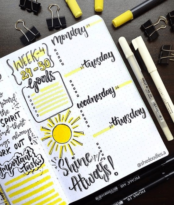 Weekly Bullet Journal Spread with Bold Days of the Week and a Bright Yellow Sun
