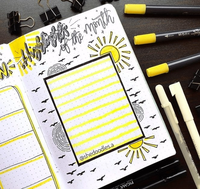 A Highlight of the month spread in a bullet journal filled with yellow suns, ripples of water and birds