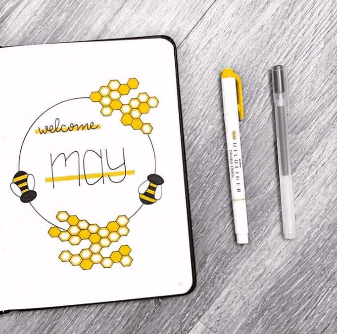 Globe Style Cover Page for May's Bullet Journal, decorated with honeycombs and bees