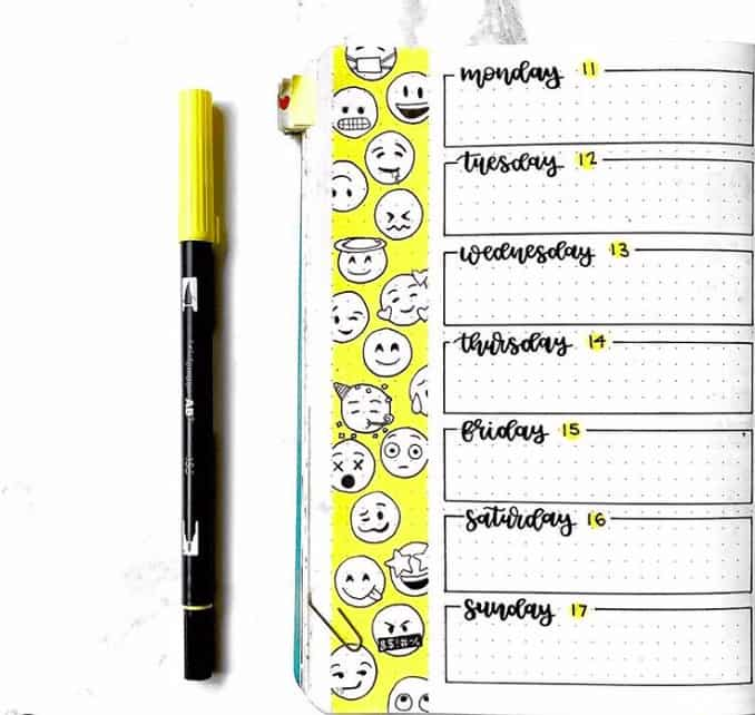 Yellow Banner With Emoji Faces with weekly spread in bullet journal